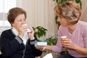 nurse monitoring patient's medication